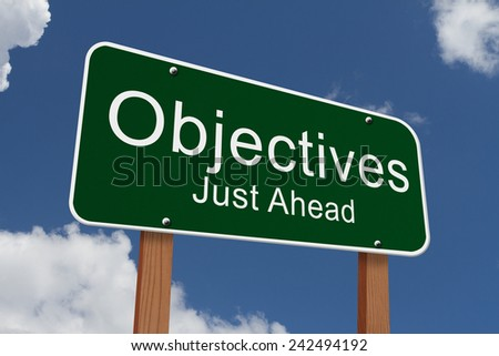 Objectives Just Ahead Sign, Green highway sign with words Objectives Just Ahead with sky background - stock photo