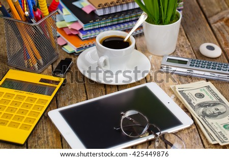 Objects for business expanded into the office on a table in the composition