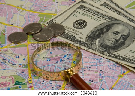 Objects for planning travel - a map, a magnifier, money - stock photo