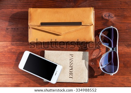 objects for travel isolated on a wooden background - stock photo