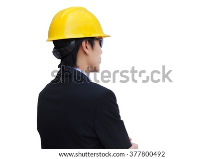 Oblique back view of asian engineer with yellow helmet on white background