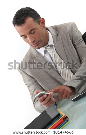 Oblique image of man dialing phone number - stock photo