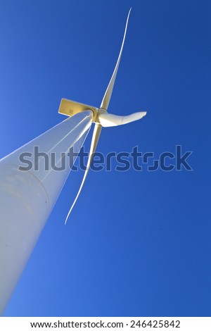 oblique view of a huge wind turbine blade taken from below - stock photo