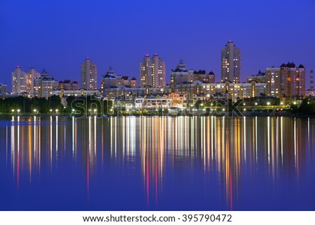Obolon embankment of the Dnieper River in Kyiv in the evening. Kiev, Capital of Ukraine - stock photo