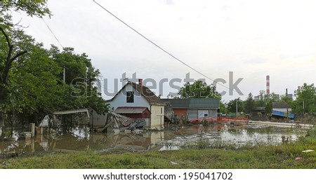 OBRENOVAC, SERBIA - MAY 24: Flood in Obrenovac on MAY 24, 2013. Flooded and ruined houses near power plant in Obrenovac, Serbia. - stock photo