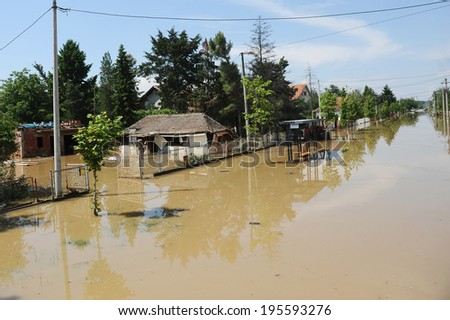 OBRENOVAC, SERBIA - MAY 20: House and street in Obrenovac under water. The water level of Sava River remains high in worst flooding on record across the Balkans on may 20, 2014