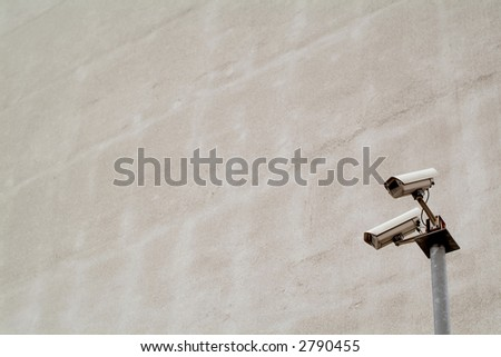 Observation cameras in front of grey wall - stock photo