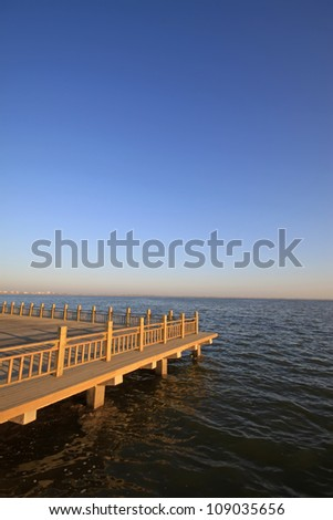 observation platform by the lake under the blue sky, Hengshui city, hebei province, China