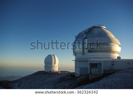 Observatories on the top of Mt. Mauna Kea, Hawaii Island at dawn - stock photo