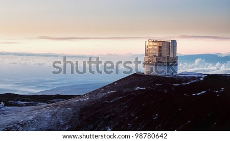 observatory at the summit of Mauna Kea in Hawaii at sunset - stock photo