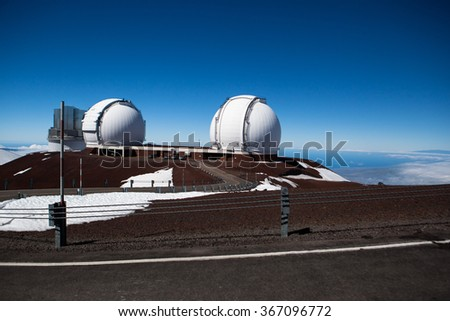Observatory domes at the peak of Mauna Kea volcano, Maui, Hawaii islands - stock photo