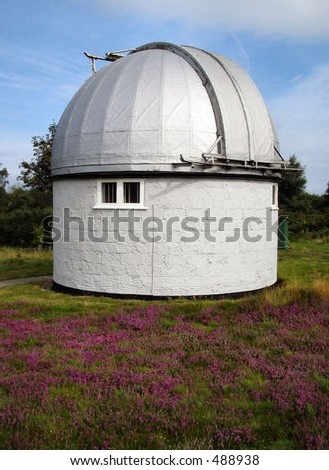 Observatory with flowers in foreground - stock photo