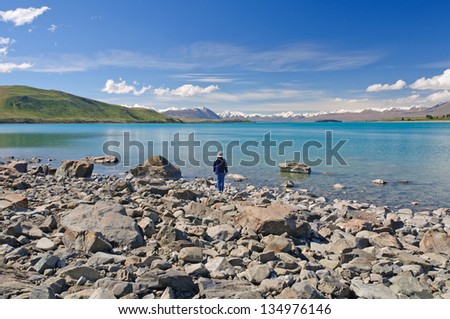 Observer at Lake Tekapo in New Zealand - stock photo