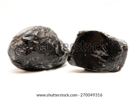 obsidian minerals, flint stone used to make tools during stone-age - stock photo