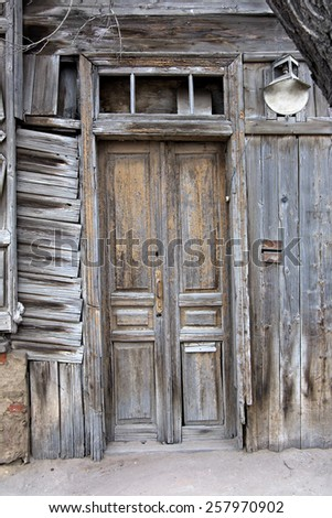 Obsolete wooden door of very old house in Astrakhan, Russia - stock photo
