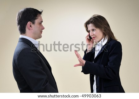 occupied manager asking her partner to wait - stock photo