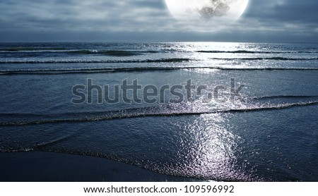 Ocean and the Moon. Night on the Beach. Large Full Moon on the Horizon. Panoramic Photo. Nature Photography Collection. - stock photo