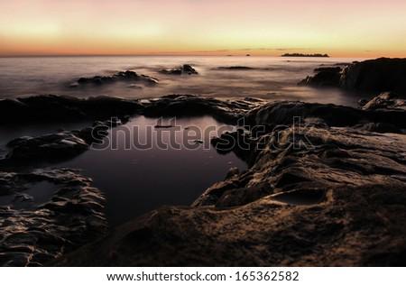 Ocean at Sunset In Uruguay - stock photo