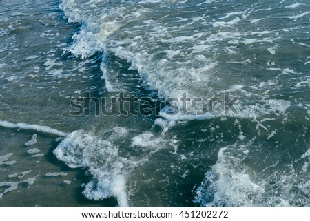 Ocean background: sea shore, turquoise waves, splashes, breaking wave, surf - stock photo