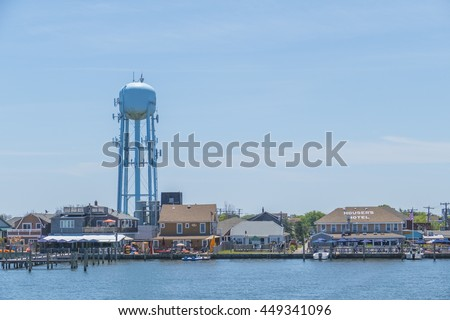 OCEAN BEACH, FIRE ISLAND, US, JULY 6, 2016: Water tower and the seashore - view form the ferry - stock photo