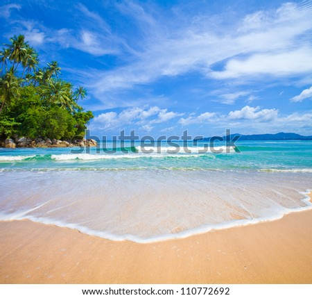 ocean beach with island and palm trees - stock photo