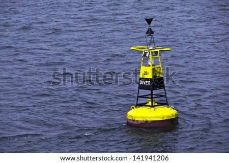 Ocean buoy; diver buoy; black and yellow; excellent copy-space  - stock photo