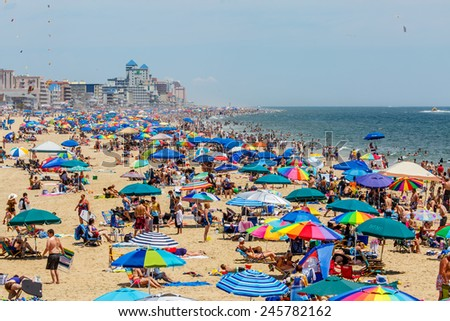 OCEAN CITY - JULY 6: Crowded beach in Ocean City, MD on July 6, 2014. Ocean City, MD is a popular beach resorts on East Coast and one of the cleanest in the country. - stock photo