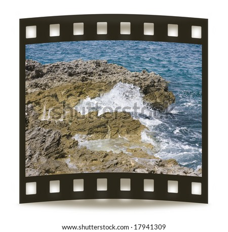 Ocean crashes against volcanic rocks - stock photo