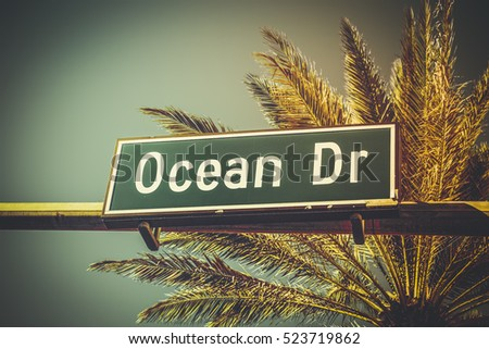 Ocean Drive sign with palm tree, Miami Beach, Florida. Vintage colors