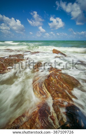 Ocean longexposure blue sky with stone