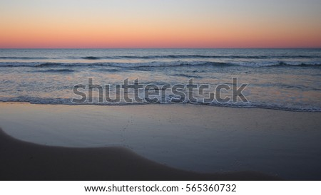 Ocean ripple on the shore at sunset