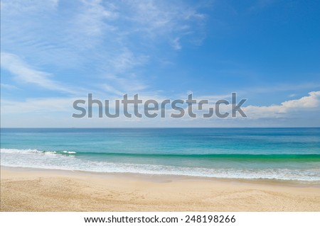 ocean, sandy beach and blue sky - stock photo