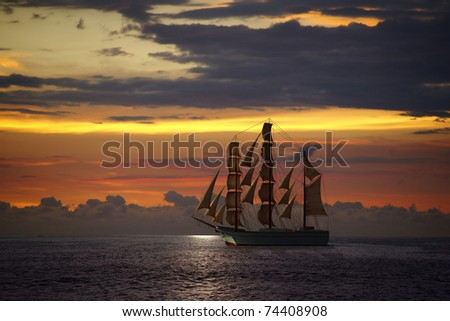 Ocean sunset and sail ship at Puerto Vallarta - stock photo