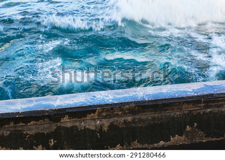 ocean surf and the old quay - stock photo