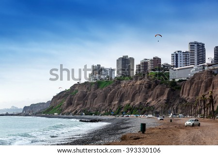 ocean surf at the big city - stock photo