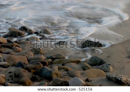 Ocean Tide Coming in over Rocks - stock photo
