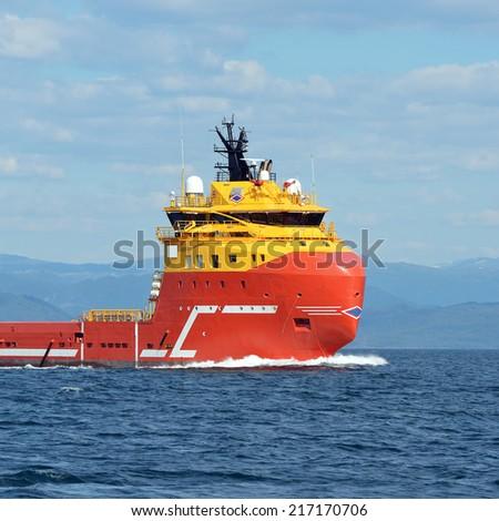 Ocean tugboat sailing in the sea - stock photo