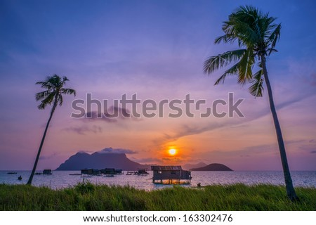 Ocean view of a sea gypsy village house on Mabul Island in Celebes Sea, Sabah, Malaysia. - stock photo
