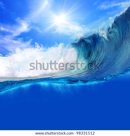 ocean-view seascape landscape Big surfing ocean wave with slightly cloudy sky and the sun