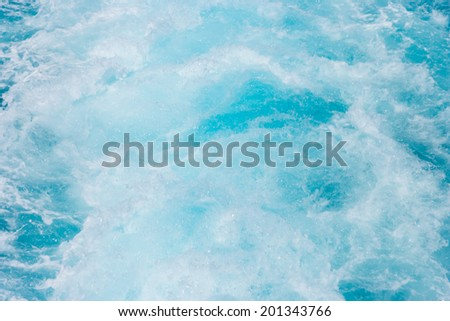 Ocean Wake in blue clear waters, blurry - stock photo