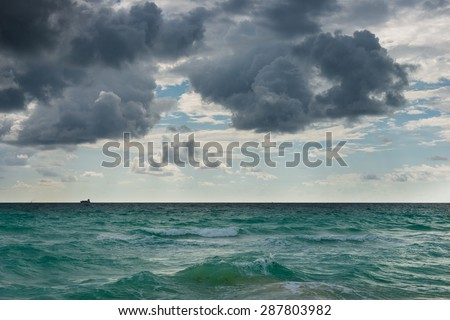 Ocean water surface under cloudy sky. Great impression of distance and solitude. - stock photo
