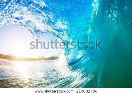 Ocean Wave at Sunrise - stock photo