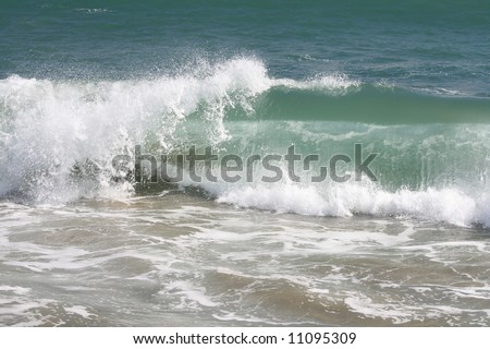 Ocean wave at the beach - stock photo
