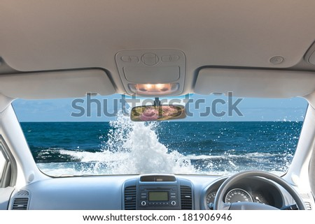 Ocean wave landscape looking out from car window - stock photo