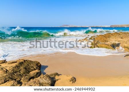 Ocean wave on Papagayo sandy beach, Lanzarote, Canary Islands, Spain - stock photo