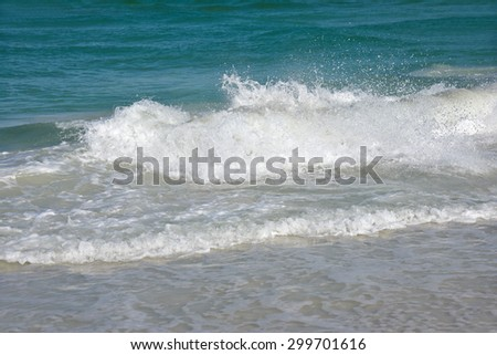 Ocean Waves of the Gulf of Mexico on the Sandy Beaches of Anna Maria Island - stock photo