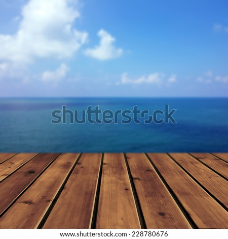 Ocean with sky and wood floor for background  - stock photo