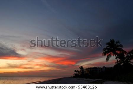 Oceanfront Beach Condominium Sunset Sanibel Island Florida - stock photo