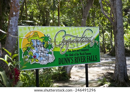 OCHO RIOS, JAMAICA - MARCH 26, 2009:  Dunn's River Falls is one of the premier attractions in Jamaica.  Thousands of visitors climb the falls every year. - stock photo