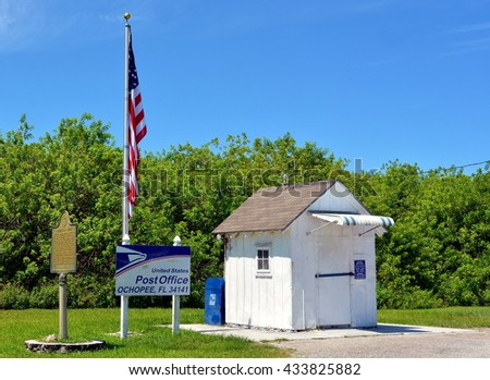 OCHOPEE, FL.-MAY29:  A very small, old, white wooden vintage United States Post Office building on May 29,2016, located in Ochopee, Florida, in the Florida Everglades on the Sawgrass Expressway. - stock photo